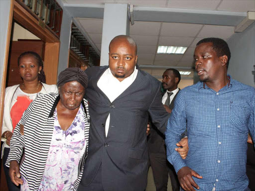 An emotional family of the late Journalist Wambui Kabiru during a past session at a Milimani court.