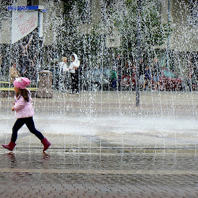 girl by Vygintas Domanskis - City,  Street & Park  Street Scenes ( girl, fountain, street, cityscape, street scene, city,  )
