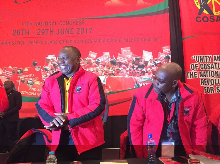Deputy President Cyril Ramaphosa arrives at Nehawu's 11th national congress at the Birchwood Hotel on June 26. He is flanked by Cosatu president Sdumo Dlamini. Picture: NEO GOBA.