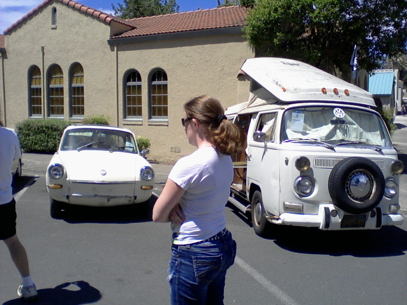 Photo: Sarah looking at the cars