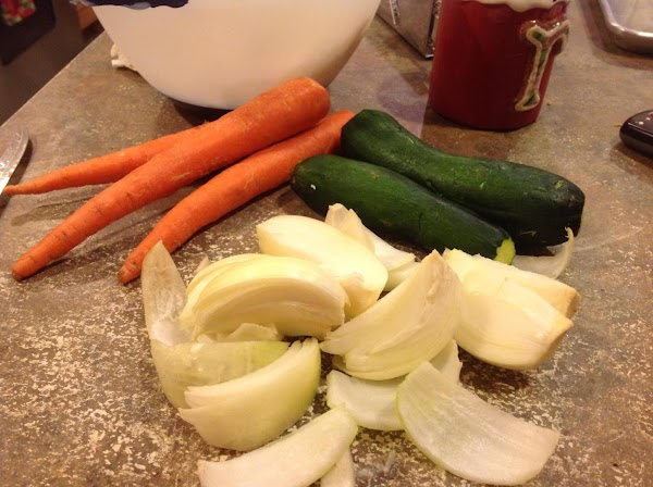 Grate the onions and shred the carrots and zucchini. I used a food processor....