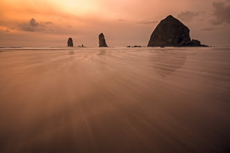 """Photo: Haystack Sunset  On Sunday when I got to Cannon Beach there wasn't any color showing in the horizon despite it being sunset. So to make the best of the situation I put on my trusty Lee Filter Holder and slid in a 1.5 ND filter to do some long exposures. The tide was coming in so I set up in the wet part of the sand, hooked up my remote trigger and ran from the incoming waves like a kid. Fortunately my tripod is heavy and took the waves like a champ. I had a number of concerned onlookers ask me if I was concerned about my camera... psssh... without risk there is no reward. This shot was the wave I was waiting for, a nice long wave with lots of bubbles. I new I'd get the nice streaking as the wave receded. """"But Brian, this photo has color?"""" you ask... yes, yes it does. The final image had a nice blue tone to it, so with a little tweak of the white balance and a run through in +onOne Software's Perfect Effects - Tada!!!"""