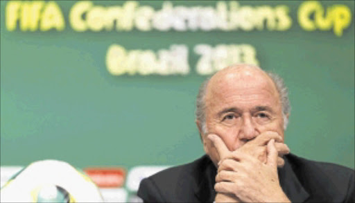 TROUBLED TIMES: Fifa president Sepp Blatter listens to a question during a news conference ahead of the Confederations Cup soccer final match yesterday  between Brazil and Spain in Rio de Janeiro        Photo: REUTERS