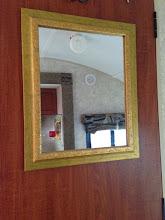 Photo: Thrift store mirror velcro stripped to bathroom door