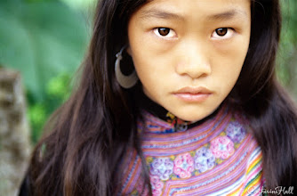 Photo: Hmong Villager in Mountain Range at Vietnam / China Border  Quick Photo Tip:  Don't be afraid to get close to your subject, even it it means cropping part of the face or head. It makes for a compelling, intimiate viewing experience.