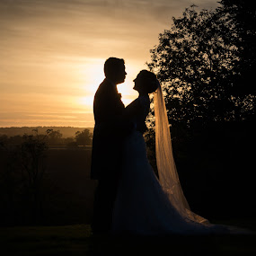 Evening Afterglow... by Nigel Hepplewhite - Wedding Bride & Groom ( sunset, silhouette, dress, wedding, veil, bride, groom,  )