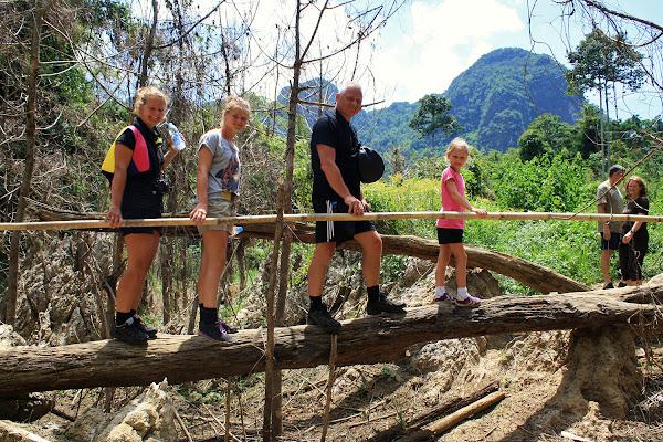Crossing a fallen log on a Khao Sok trek