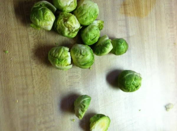 Cut the ends of the Brussels sprouts off and cut in half. If they...