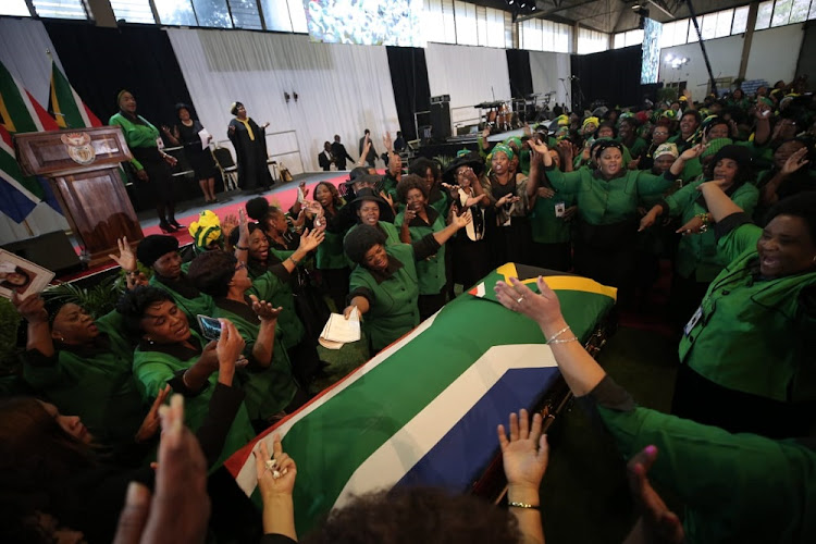 Members of the ANC Woman's league sing struggle songs around the coffin of the late minister of environmental affairs, Edna Molewa at her funeral in Pretoria. Picture: ALAISTER RUSSELL/THE SUNDAY TIMES