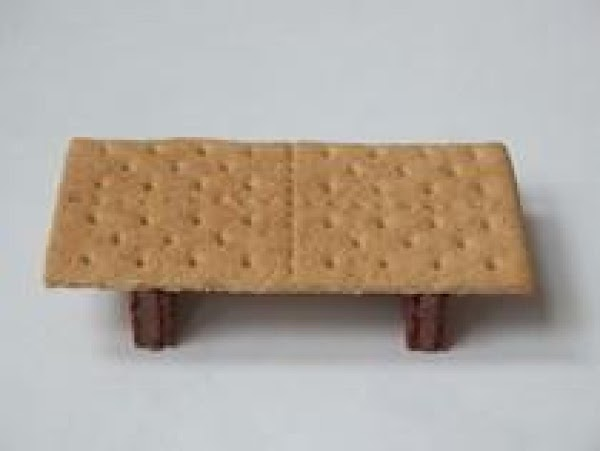 For the table:  1.  Secure all food on top of graham cracker with frosting. 2....