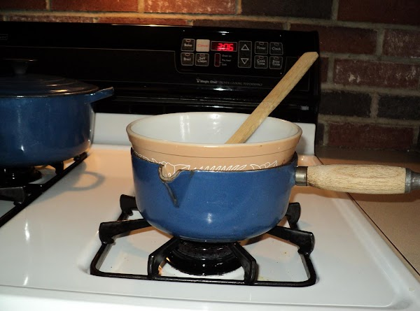 Combine egg whites, sugar, coconut and almond extract in one heat proof bowl (I...