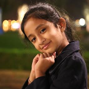 Cute baby by Manoj Ojha - Babies & Children Child Portraits ( majaz, uae, emirate, indian, india, night, baby, cute, waterfront, light, sharjah )