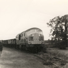 Photo: Coupling to the trucks in the siding for returning to Oxford (1969?)