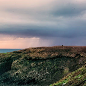 Sunset Squall-Yaquina Head Lighthouse, Newport, Or. by Mike Moss - Landscapes Sunsets & Sunrises