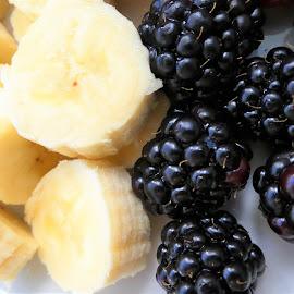 A banana and the brambles by Svetlana Saenkova - Food & Drink Fruits & Vegetables ( banana, black and yellow, blackberries, berries )