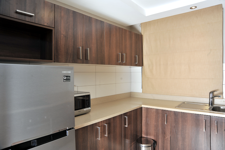 Fully equipped kitchen at Harry Thuku Street Apartments