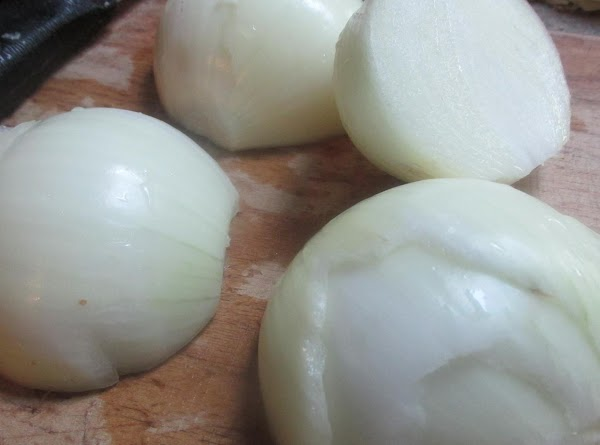 Peel onions, cut in half then slice into medium thick slices, then cut slices...