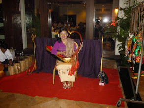 Photo: This lady entertained us at our hotel with a hand-held harp.