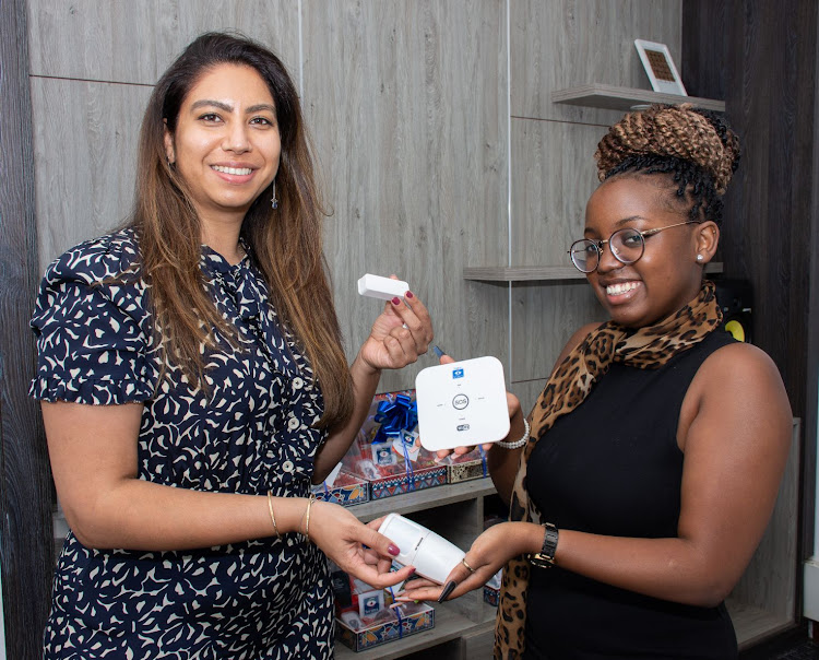 Head of the Innovation Lab at Securex Agencies,Rachna Sahni, showcases the newly launched smart home security kit, Rafiki by Securex, to a customer Stephanie Mulinge/HANDOUT