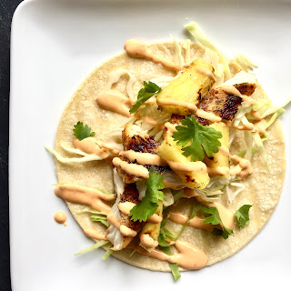 Quick Grilled Fish + Pineapple Tacos with Chipotle Sour Cream.