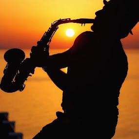 Playing at sunset  by Aurelio Firmo - People Musicians & Entertainers