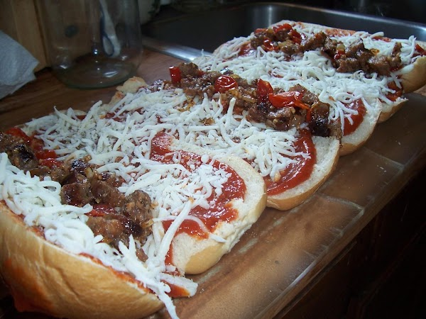 Place sandwich style pepperoni and approximately 2T. of Italian sausage mixture on one side...