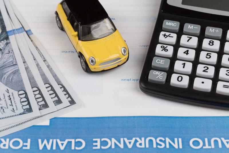 toy car sitting next to money