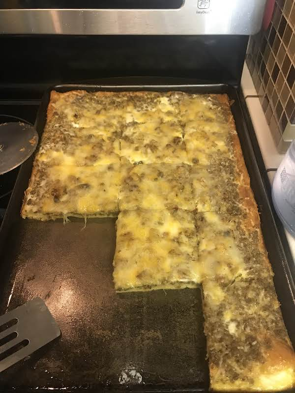Yummy Breakfast Pizza, A Meal In A Slice - Eggs, Hash Browns, Sausage And Gooey Cheese.