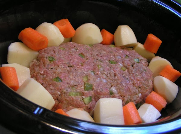 Form meat mixture into a loaf and place in the center of Crock Pot....