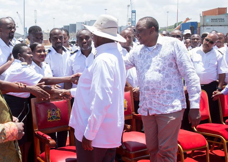 President Uhuru Kenyatta and Ugandan President Yoweri Museveni greet Kenya Ports Authority staff when they toured the Port of Mombasa.