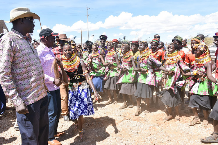 Deputy President William Ruto with Governor Joseph Nanok (Turkana) and James Lomenen (MP Turkana South) join traditional dancers during a tour of Turkana County where he launched development projects.