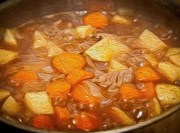 Add the warm broth to the pot and bring to a slight boil over...