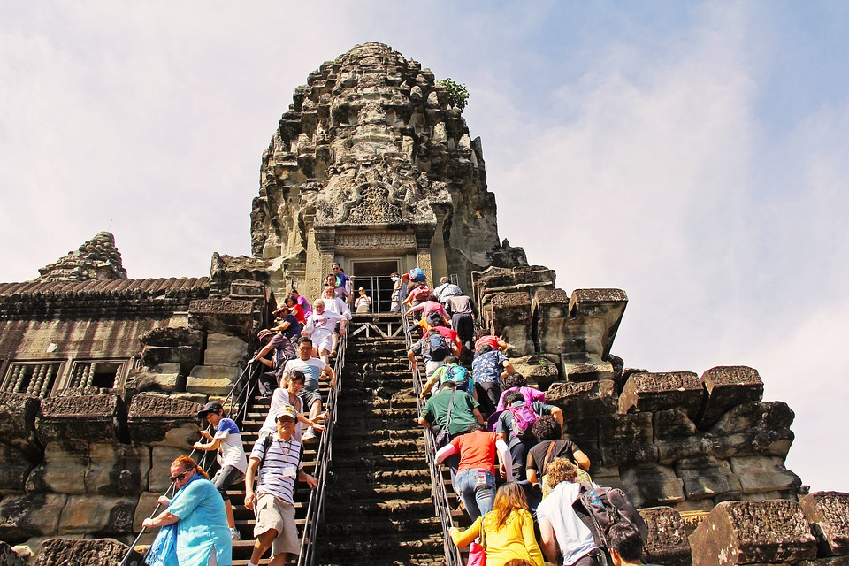 Visitors or tourists on the Entrance staircase of Angkor wat temple.