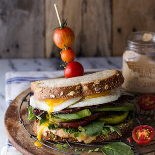 Bourbon Caramelized Bacon and Heirloom Tomato BLT w/Fried Eggs + Smoked Gouda.