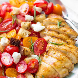 Grilled Chicken Salad With Tomatoes, Croutons And Goat Cheese.