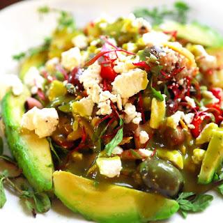 Vitamin Rich Mediterranean Avocado Salad With Bull's Blood Microgreens.