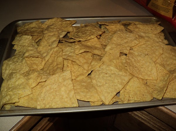 Now line a 10x15 cookie sheet that has sides to it with tortilla chips...