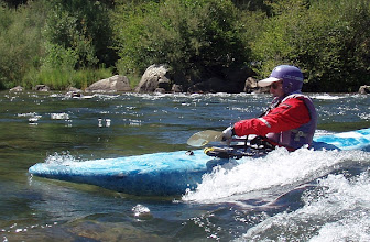 Photo: Playboating on the wave above Camp Lotus.