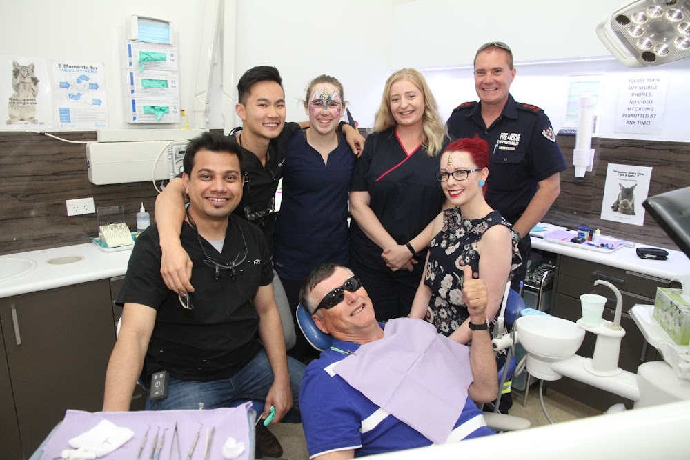 Dentists Dr Aashish Kaphle, Dr Carl Pan, dental assistants Billie Strong, Karissa Boonstra and Lisa Dickinson with patients Don Rowe, in the chair, and Shane Bradford, right.