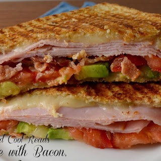 Grilled Cheese Sandwich with Bacon, Tomato, Avocado & Ham.