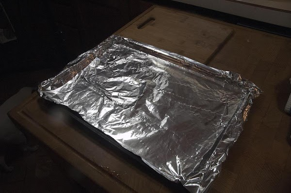 Take a walled baking sheet and line with foil.