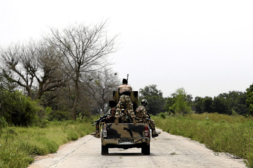 Hot spot: A file picture shows a military vehicle driving along the Konduga-Bama road in Bama, in Borno state, in 2016. Picture: REUTERS