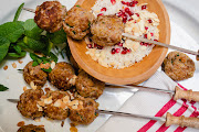 Bobotie kebabs with feta and pomegranate rice salad.