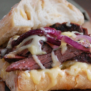 Grilled Steak Sandwich with Smoked Gouda and Red Onion.