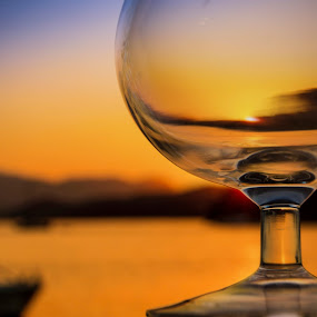 Tasting The Sun   by John Siryana - Artistic Objects Glass ( cup, wine, orange, sky, sunset, drink, boats, glass, beach, blur, sun )