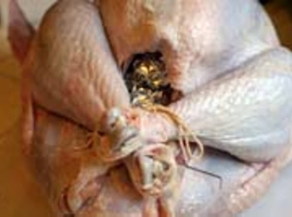 Tie Your Legs of the turkey together with twine or String to Keep legs...