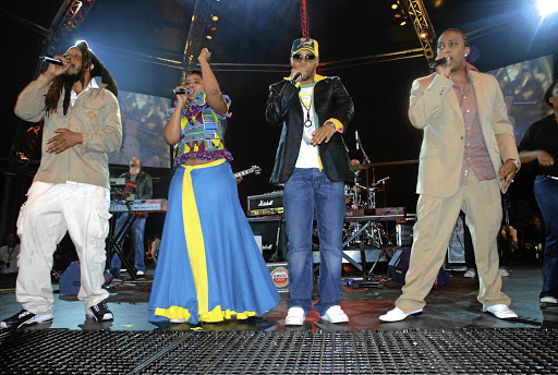Afro-pop group Bongo Maffin performing live on stage. From left to right are Jah Seed, Thandiswa Mazwai, Stoan Seate and Speedy.
