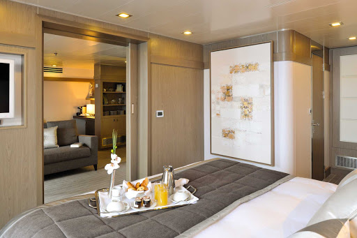 Ponant-Austral-suite.jpg - Enjoy breakfast in bed in your suite when entering a new port on Ponant's L'Austral.