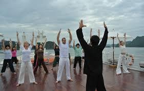 Image result for tập thể dục buổi sáng trên tàu hạ long
