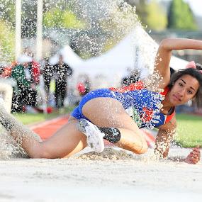 Sand Splash by Justin Quinn - Sports & Fitness Running ( sand, track and field, longjump, ncaa, women, jump )